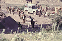 Iraq 1983 <br /> In Haj Omran, in july, peshmergas of KDP looking at Iranian soldiers on their way to attack the Iraqi army   <br /> Irak 1983 <br /> A Haj Omran,mois de juillet,  les peshmergas du KDP regardent les soldats iraniens montant au front.