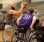 MARSHALL, MN - MARCH 17:  Ryan Morich #34 from Alabama shoots over Dylan Fischbach #30 form the University Wisconsin Whitwater during their championship game at the 2018 National Intercollegiate Wheelchair Basketball Tournament at Southwest Minnesota State University in Marshall, MN. (Photo by Dave Eggen/Inertia)