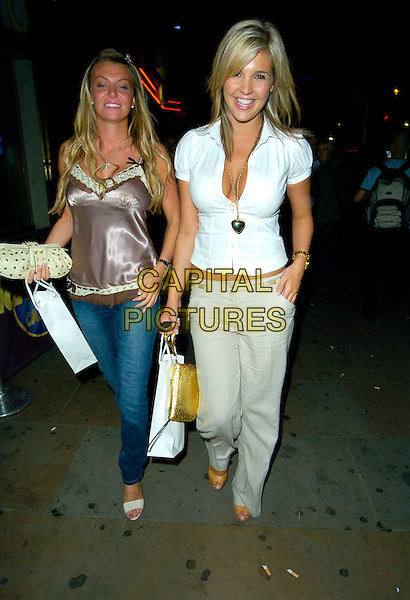 DANIELLE LLOYD (R) & GUEST.At the Evite.co.uk Website Launch Party, Cafe De Paris,.London, England, 12th July 2007..full length white shirt blouse cleavage heart necklace beige wide leg trousers Dannielle.CAP/CAN.©Can Nguyen/Capital Pictures