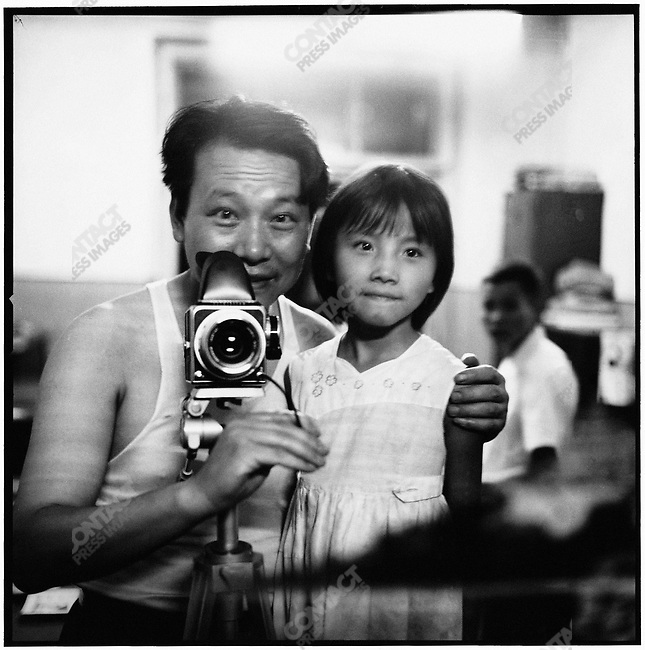 Li with his daughter Xiaobing in his office at the Heilongjiang Daily (photographed with a self-timer). 12 July 1976