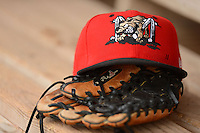 Batavia Muckdogs hat and glove sitting on the bench during a game against the Jamestown Jammers on June 27, 2013 at Dwyer Stadium in Batavia, New York.  The game was postponed during the fourth inning due to rain.  (Mike Janes/Four Seam Images)