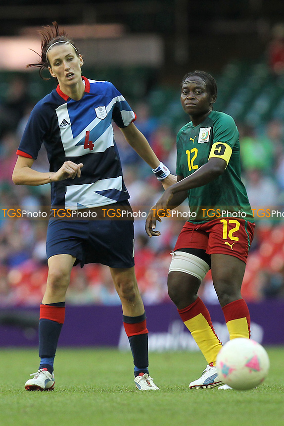 Jill SCOTT of Great Britain and Francoise BELLA of Cameroon - Great Britain Women vs Cameroon Women - Womens Olympic Football Tournament London 2012 Group E at the Millenium Stadium, Cardiff, Wales - 28/07/12 - MANDATORY CREDIT: Gavin Ellis/SHEKICKS/TGSPHOTO - Self billing applies where appropriate - 0845 094 6026 - contact@tgsphoto.co.uk - NO UNPAID USE.