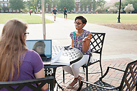 Olivia M. Zeringue, a transfer student from Southaven, left, and Kendris K. Lacey, a freshman biological sciences major from Canton, enjoy a between-class break under the shade of an umbrella at Union Plaza. Located between Colvard Student Union and McCool Hall, the new spot features seating and tables for added outdoor dining space, as well as fresh landscaping. The Class of 2015, along with the university's Alumni Delegates, Interfraternity Council, Music Maker Productions, National Panhellenic Council, Residence Hall Association, Student Association, Alpha Delta Pi, Chi Omega, Delta Gamma and Pi Beta Phi sororities, and Kappa Sigma and Lambda Chi Alpha fraternities, played a role in making the new gathering place possible.<br />