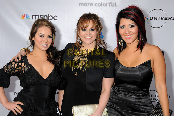 "RAQUEL ""RAQ-C"" CORDOVA, JENNI RIVERA & JANNEY ""CHIQUIS"" MARIN.The Cable Show 2010 ""An Evening with NBC Universal"" held at Universal Studios Hollywood, Universal City, California, USA..May 12th, 2010.half length black dress lace strapless gold necklace hand on hip over shoulder arm.CAP/ADM/BP.©Byron Purvis/AdMedia/Capital Pictures."