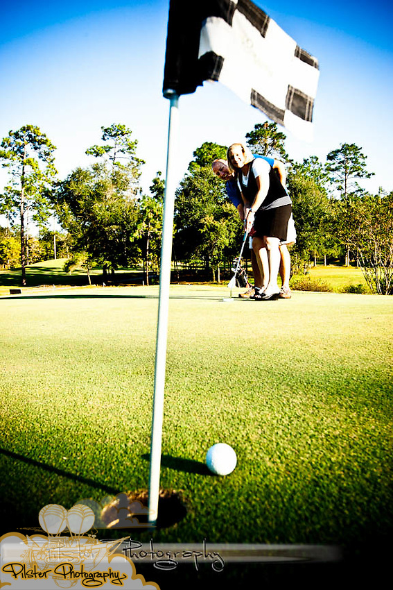 Kristin Franklin and Eli Gallup play around on the golf course Monday, October 25, 2011 at Victoria Hills Golf Club in DeLand, Florida. Eli has been playing golf for a while and has recently helped Kristin get started. (Chad Pilster of http://www.PilsterPhotography.net)