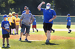 WATERBURY CT. - 01 August 2020-080120SV01-Fernando Spagnolo, police chief, throws out the first pitch during the Waterbury Police Activity League (PAL) end of season Summer Baseball Tournament at Municipal Stadium in Waterbury Saturday.<br /> Steven Valenti Republican-American