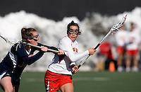Brandi Jones (4) of Maryland is checked by Tara Coyle (29) of Richmond at the practice turf field in College Park, Maryland.  Maryland defeated Richmond, 17-7.