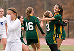 MIDDLETOWN, CT-111817JS25- Holy Cross' Alyssa Hebb (16) and Erin Goggin (3) congratulate Adalisse Padilla (10) after she scored on a penalty kick during their Class S state final game against Old Lyme Saturday at Middletown High School.<br /> Jim Shannon Republican-American