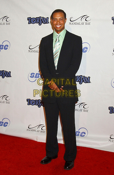 TIGER WOODS.Tiger Jam VIII benefiting the Tiger Woods Foundation held at Mandalay Bay Resort & Casino, Las Vegas, Nevada.May 21st, 2005.Photo Credit: Laura Farr/AdMedia.full length black suit.www.capitalpictures.com.sales@capitalpictures.com.© Capital Pictures.
