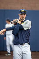 Michigan Wolverines pitcher Ben Dragani (21) stretches before the NCAA baseball game against the Michigan State Spartans on May 7, 2019 at Ray Fisher Stadium in Ann Arbor, Michigan. Michigan defeated Michigan State 7-0. (Andrew Woolley/Four Seam Images)