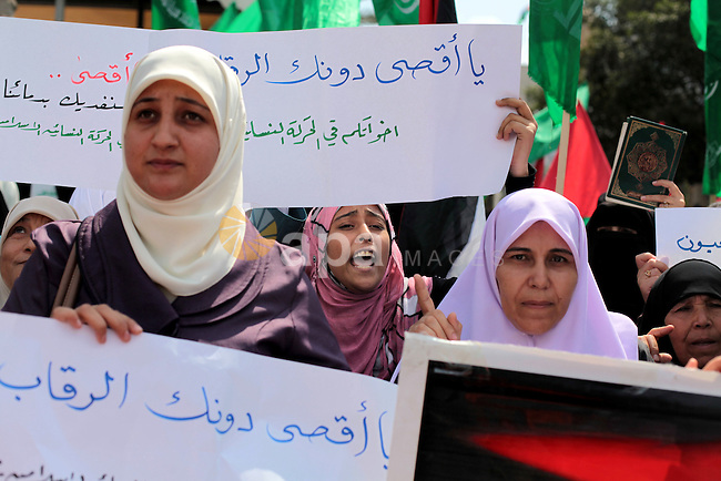 Palestinian women shout slogans during a protest organised by the Hamas movement in Gaza City on September 24, 2013, amid recent tensions among Palestinians regarding Israel's admittance of visitors to a holy site in Jerusalem's Old City which houses the al-Aqsa mosque compound, and which Jews revere as the vestige of their ancient temples. Photo by Ashraf Amra