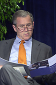 United States President George W. Bush reads about the Malcolm Baldridge Awards prior to the ceremony in Alexandria, Virginia on April 6, 2001.  Prior to his prepared remarks, The President announced that General Sealock had seen the 24 Navy detainees in China.<br /> Credit: Ron Sachs - Pool / CNP