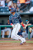 Jacksonville Jumbo Shrimp right fielder John Norwood (22) follows through on a swing during a game against the Mobile BayBears on April 14, 2018 at Baseball Grounds of Jacksonville in Jacksonville, Florida.  Mobile defeated Jacksonville 13-3.  (Mike Janes/Four Seam Images)