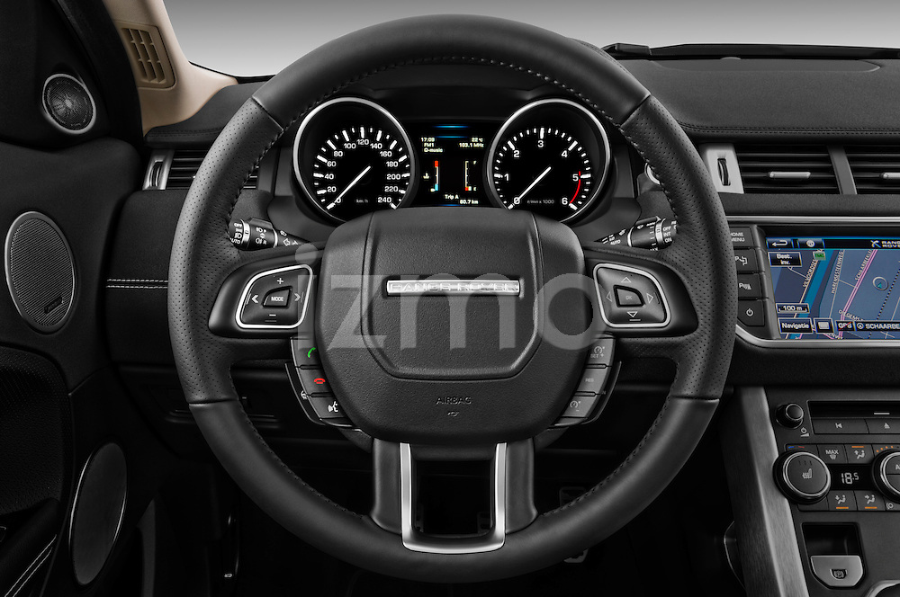 Steering wheel view of a 2011 Land Rover Range Rover Evoque SUV