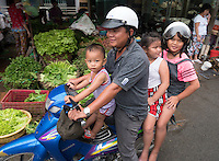 Four on a Bike. Life in the Mekong Delta Vietnam