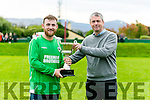 Barry John Keane, captain of the winning team  Boy from the Avenue   was presented with the trophy by Pa Daly the  Inter Firm seven a-side soccer blitz  in aid of local charities at the Low Field, Tralee on Saturday