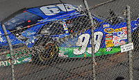 Apr 26, 2009; Talladega, AL, USA; NASCAR Sprint Cup Series driver Carl Edwards slides along the track after making contact with the catch fence on the last lap during the Aarons 499 at Talladega Superspeedway. Mandatory Credit: Mark J. Rebilas-