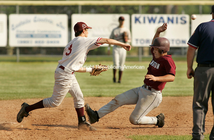 TORRINGTON, CT - 02 JUNE 2005 -060205JS04--Torrington's Jerry Colon tries to break up a double play attempt by Bethel's Brendon Meadows during their CIAC Class L tournament game at Fuessenich Park in Torrington on Thursday.   --Jim Shannon Photo--Torrington; Brendon Meadows; Bethel, Jerry Colon are CQ