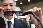October 4, 2016, Chiba, Japan - Japanese venture QD Laser president Mitsuru Sugawara displays a retinal imaging eyewear - which can project digital images onto the user's retina using laser beams for low vision patients at the CEATEC Japan 2016 in Chiba, suburban Tokyo on Tuesday, October 4, 2016.The retinal projection laser eyewear received Economy Minister's Award and is expecting to sell next year.   (Photo by Yoshio Tsunoda/AFLO) LWX -ytd-