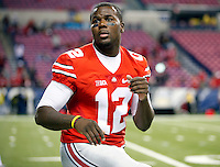 Ohio State Buckeyes quarterback Cardale Jones (12) warms up before their game against Wisconsin Badgers in the 2014 Big Ten Football Championship Game at Lucas Oil Stadium in Indianapolis, Ind. on December 6, 2014.  (Dispatch photo by Kyle Robertson)