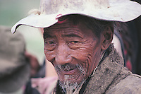 The lined face and straggly beard of this old man in Tsedang, Tibet indicate that he is extremely old but the harsh life lead by peasants in the Himalayan mountains makes them age prematurely.