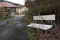 Empty buildings and overgrown vegitation in the abandoned village of Tsushima in Fukushima, Japan. Friday May 4th 2012. After the explosions at the daichi nuclear plant caused by the March 11th 2011 earthquake and tsunami. High levels of radioactive contamination in this village have made it uninhabitable.