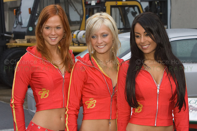 MONTREAL - JUNE 22: Budweiser girls (Bud girls) pass out literature and pose for photographs during the Bridgestone Open House Day on the Thursday prior to race weekend of the  Canadian F1 Grand Prix at the Circuit Gilles-Villeneuve June 22, 2006 in Montreal, Canada.