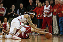 March 9, 2014: Terran Petteway (5) of the Nebraska Cornhuskers and Josh Gasser (21) of the Wisconsin Badgers go after a loose ball during the first half at the Pinnacle Bank Arena, Lincoln, NE. Nebraska 77 Wisconsin 68.