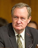 "United States Senator Mike Crapo (Republican of Idaho), Ranking Member, U.S. Senate Committee on Banking, Housing and Urban Affairs, listens to testimony from Janet L. Yellen, Chair, Board of Governors of the Federal Reserve System, on ""The Semiannual Monetary Policy Report to the Congress."" on Capitol Hill in Washington, D.C. on Tuesday, July 15, 2014.<br /> Credit: Ron Sachs / CNP"
