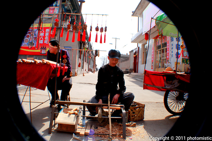 street vendor/carpenter outside the Qiao Family Courtyard<br /> Shanxi, China