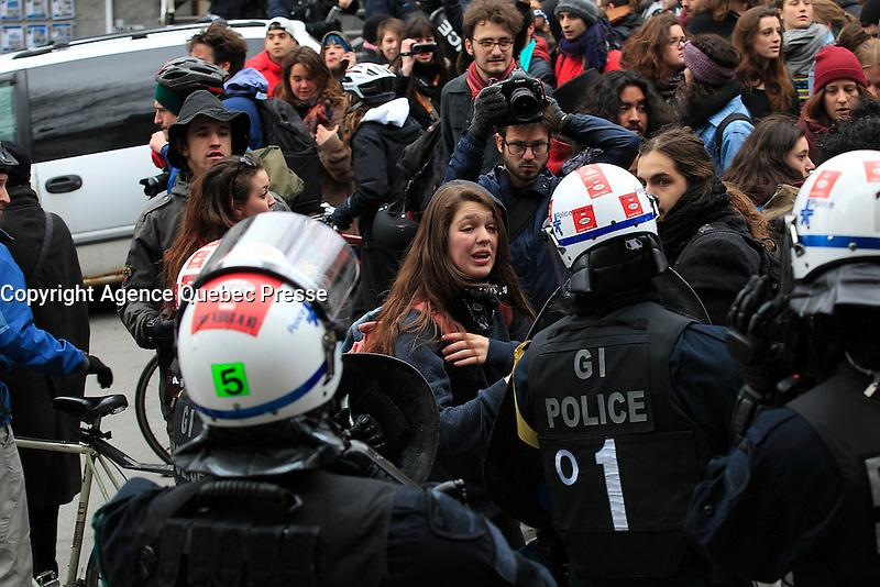 FILE PHOTO -  Montreal Police arrest anti-austerity demonstrators, April 9, 2015<br /> <br /> PHOTO : Pierre Roussel - Agence Quebec Presse