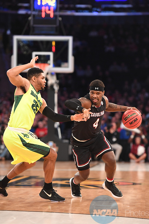 NEW YORK, NY - MARCH 24: Rakym Felder (4) of the University of South Carolina is guarded by Al Freeman (25) of Baylor University during the 2017 NCAA Men's Basketball Tournament held at Madison Square Garden on March 24, 2017 in New York City. (Photo by Justin Tafoya/NCAA Photos via Getty Images)
