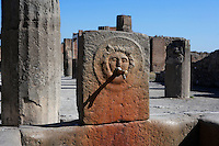 Fountain on Via delle Scuole, Pompeii, with its spout still in place. One of 42 public fountains fed by lead piping from water towers around the city