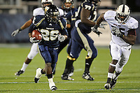 6 November 2010:  FIU running back Darrian Mallary (26) carries the ball while being pursued by Louisiana-Monroe linebacker Cameron Blakes (35) in the third quarter as the FIU Golden Panthers defeated the University of Louisiana-Monroe Warhawks, 42-35 in double overtime, at FIU Stadium in Miami, Florida.