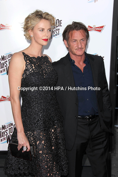 """LOS ANGELES - MAY 15:  Charlize Theron, Sean Penn at the """"A Million Ways To Die In The West"""" World Premiere at Village Theater on May 15, 2014 in Westwood, CA"""