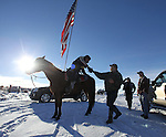 Duane Ehmer, of Irrigon, Oregon, left, greets Brad Williams, who joined the armed activists at the Malheur National Wildlife Reserve on January 15, 2016 in Burns, Oregon. Ehmer has been pulling sentry duty during the takeover. Ammon Bundy and about 20 other protesters took over the refuge on Jan. 2 after a rally to support the imprisoned local ranchers Dwight Hammond Jr., and his son, Steven Hammond.  ©2016. Jim Bryant Photo. All Rights Reserved.
