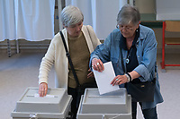 Women casts their votes during the European Parliamentary election in Budapest, Hungary on May 26, 2019. ATTILA VOLGYI