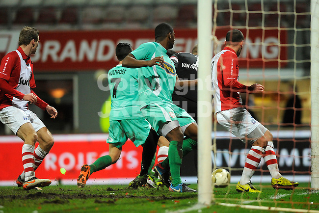 EMMEN - Voetbal, FC Emmen - FC Dordrecht, Jens Vesting, seizoen 2013-2014, 07-02-2014,   FC Dordrecht speler Jessy Mayele  komt te laat de bal gaat voorlangs