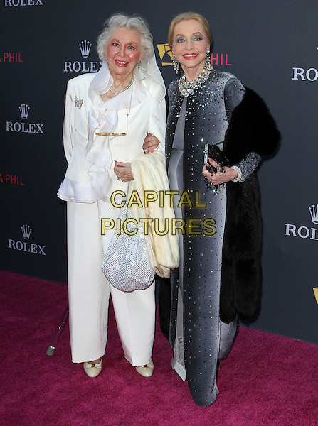 ANN RUTHERFORD & ANNE JEFFREYS.Los Angeles Philharmonic 2010/2011 Season Opening Night Gala held at The Disney Concert Hall.  .October 7th, 2010.full length white black grey gray trousers jacket dress bag ruffle.CAP/ADM/KB.©Kevan Brooks/AdMedia/Capital Pictures.