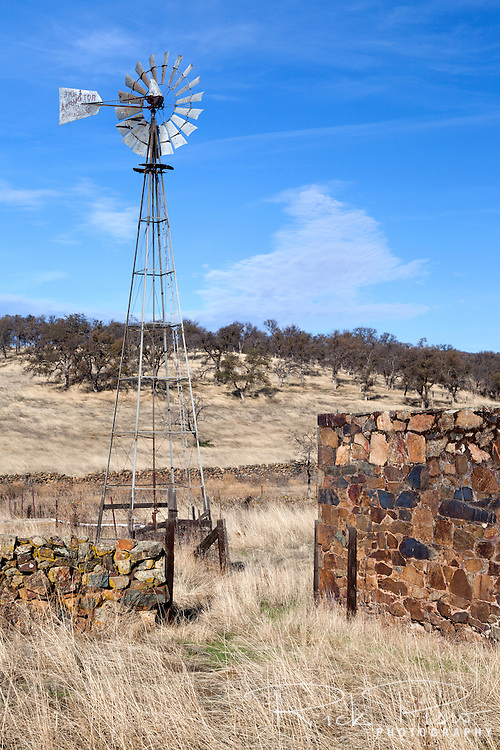 Windmill and rock wall at Telegraph City in Calaveras County, California.