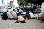 Tunis, Tunisia. January 26th 2011.Men pray in a street near the Casbah.....