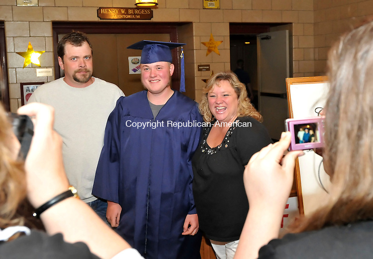 FALLS VILLAGE, CT-28 MAY 2009-052809JS03-Foothills Adult and Continuing Education graduate Bryan C. McBreairty, center, of Warren, poses for a photo with his father Bryan T. McBreairty and mother Cathy Wyskil prior to graduation ceremonies Thursday at Housatonic Valley Regional High School in Falls Village. <br /> Jim Shannon Republican-American