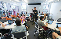 "Christopher Gilman, visual information specialist and instructional designer, assists Jacob Sargent, Associate Director, Center for Digital Liberal Arts, with his CSP class, ""Liberal Arts on the Brink?"" in the Varelas Innovation Lab in Johnson Hall, April 18, 2014. (Photo by Marc Campos, Occidental College Photographer)"