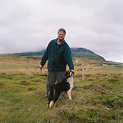 L&aacute;rus Sverrison, 47 y.o., farmer, and &Uacute;a, 10 months old, his border-collie sheep dog. Border-collie is the most common in Iceland kind of dog. In rural areas probably the only kind. It was imported either from England or from Scotland, and completely outlived the indigenous Icelandic sheep dog that resembled a wolf more than anything, but a smaller kind. It was a cross between a Russian eskimo dog and something else, most probably a wolf. I once saw such a dog in Reykjavik and still regret not having taken a picture of it. It was probably the last of the kind. <br /> I met L&aacute;rus on Monday, October the 14th, at about 12 a.m., when, coming back from a waterfall I scattered his sheep. He was repairing his fence, but was very friendly with me and not at all annoyed at a trespassing photographer. We weren&rsquo;t able to do much talking though, as L&aacute;rus doesn&rsquo;t speak any English. The thing is, farmers, especially in secluded areas like the thereabouts of Grundarfj&ouml;r&eth;ur, live a rather isolated life and don&rsquo;t meet a many strangers that they would need to speak any foreign languages with. The weather was calm and warm, with no wind.