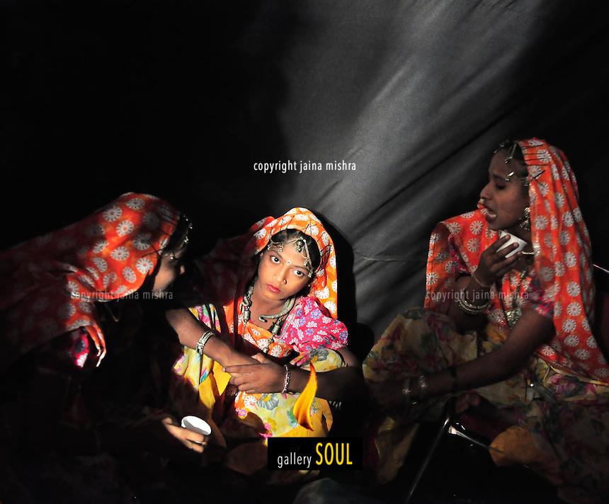 Folk dancers taking a break, Gujarat, India