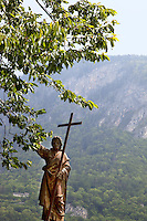 Switzerland. Canton Valais. St-Maurice. Africa Saints Pilgrimage (Pèlerinage aux Saints d'Afrique). Golden statue of Jesus Christ and the cross. The first part of the pilgrimage takes place in Véroliez which is a part of the town of St-Maurice. 2.06.13 © 2013 Didier Ruef