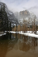 Yosemite Falls and the Merced River in Yosemite National Park, after a spring storm.