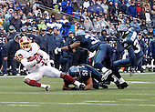 SEATTLE, WA. 01/14/06 Meeting for the second time this season, The Washington Redskins and the Seattle Seahawks will do battle at Quest Field to see which team will advance to the NFC Championship Playoff. Redskins WR Santana Moss catches a Mark Brunell pass in tripple coverage for a 14 yard gain to the 10 yard line setting up a John Hall field goal for the first score of the game. Photo by Arnie Sachs/CNP