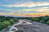 We capture this sunset image in the Texas Hill Country near Kingsland at Sandy Creek. Sandy Creek is usually a dry sandy creeek but this spring we had a little water flowing through we thought it made for a beautifull image. We also had quite a few birds flying at this time of the evening so I left them in the image.