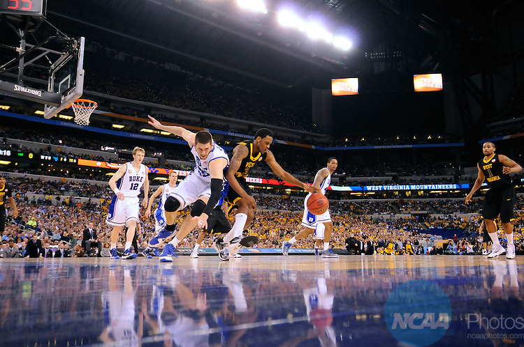 3 APR 2010: Devin Ebanks of West Virginia fights for control of a loose ball against Brian Zoubek (55) from Duke during the semi final game of the Men's Final Four Basketball Championships held at Lucas Oil Stadium in Indianapolis, IN. Duke went on to defeat West Virginia 78-57 to advance to the championship game. Rich Clarkson/NCAA Photos